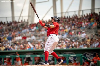 FT. MYERS, FL - FEBRUARY 25: Christian Vazquez #7 of the Boston Red Sox hits an RBI doublers during the third inning of a Grapefruit League game against the Baltimore Orioles on February 25, 2020 at jetBlue Park at Fenway South in Fort Myers, Florida. (Photo by Billie Weiss/Boston Red Sox/Getty Images) *** Local Caption *** Christian Vazquez