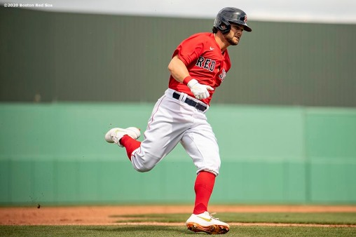 FT. MYERS, FL - FEBRUARY 25: Andrew Benintendi #16 of the Boston Red Sox rounds third base to score during the third inning of a Grapefruit League game against the Baltimore Orioles on February 25, 2020 at jetBlue Park at Fenway South in Fort Myers, Florida. (Photo by Billie Weiss/Boston Red Sox/Getty Images) *** Local Caption *** Andrew Benintendi