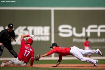 FT. MYERS, FL - FEBRUARY 27: Rhys Hoskins #17 of the Philadelphia Phillies evades the tag of Tzu-Wei Lin #5 of the Boston Red Sox after hitting a double during the third inning of a Grapefruit League game on February 27, 2020 at jetBlue Park at Fenway South in Fort Myers, Florida. (Photo by Billie Weiss/Boston Red Sox/Getty Images) *** Local Caption *** Rhys Hoskins; Tzu-Wei Lin