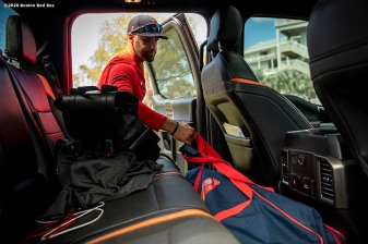 FT. MYERS, FL - FEBRUARY 28: J.D. Martinez #28 of the Boston Red Sox grabs his bag as he arrives to CenturyLink Sports Complex for a Grapefruit League game against the Minnesota Twins on February 28, 2020 in Fort Myers, Florida. (Photo by Billie Weiss/Boston Red Sox/Getty Images) *** Local Caption *** J.D. Martinez
