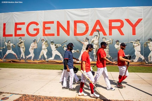 FT. MYERS, FL - MARCH 5: Members of the Boston Red Sox walk past a sign before a Grapefruit League game against the Houston Astros on March 5, 2020 at jetBlue Park at Fenway South in Fort Myers, Florida. (Photo by Billie Weiss/Boston Red Sox/Getty Images) *** Local Caption ***