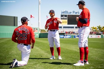 FT. MYERS, FL - MARCH 7: J.D. Martinez #28, Bobby Dalbec #29 and Andrew Benintendi #16 of the Boston Red Sox warm up before a Grapefruit League game against the Toronto Blue Jays on March 7, 2020 at jetBlue Park at Fenway South in Fort Myers, Florida. (Photo by Billie Weiss/Boston Red Sox/Getty Images) *** Local Caption *** Andrew Benintendi; Bobby Dalbec; J.D. Martinez
