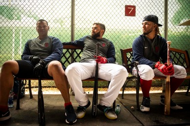FT. MYERS, FL - MARCH 8: Rafael Devers #11, Jose Peraza #3, and Jonathan Arauz #26 of the Boston Red Sox look on before a Grapefruit League game against the Minnesota Twins on March 8, 2020 at jetBlue Park at Fenway South in Fort Myers, Florida. (Photo by Billie Weiss/Boston Red Sox/Getty Images) *** Local Caption *** Rafael Devers; Jose Peraza; Jonathan Arauz