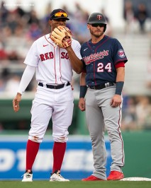 FT. MYERS, FL - MARCH 8: Xander Bogaerts #2 of the Boston Red Sox talks with Josh Donaldson #24 of the Minnesota Twins during the first inning of a Grapefruit League game on March 8, 2020 at jetBlue Park at Fenway South in Fort Myers, Florida. (Photo by Billie Weiss/Boston Red Sox/Getty Images) *** Local Caption *** Xander Bogaerts; Josh Donaldson
