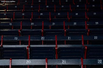 BOSTON, MA - APRIL 9: Four seats are reserved as season tickets for medical workers as medical professionals from Beth Israel Deaconess Medical Center are welcomed onto the empty field at Fenway Park in recognition of their work during the coronavirus pandemic on April 9, 2020 at Fenway Park in Boston, Massachusetts. The welcoming was filmed for the 'Some Good News With John Krasinski' YouTube series. (Photo by Billie Weiss/Boston Red Sox/Getty Images) *** Local Caption ***