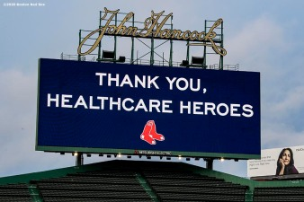 BOSTON, MA - APRIL 9: The scoreboard displays a message as medical professionals from Beth Israel Deaconess Medical Center are welcomed onto the empty field at Fenway Park in recognition of their work during the coronavirus pandemic on April 9, 2020 at Fenway Park in Boston, Massachusetts. The welcoming was filmed for the 'Some Good News With John Krasinski' YouTube series. (Photo by Billie Weiss/Boston Red Sox/Getty Images) *** Local Caption ***
