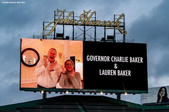 BOSTON, MA - APRIL 9: The scoreboard displays a video message from Massachusetts Governor Charlie Baker and Lauren Baker as medical professionals from Beth Israel Deaconess Medical Center are welcomed onto the empty field at Fenway Park in recognition of their work during the coronavirus pandemic on April 9, 2020 at Fenway Park in Boston, Massachusetts. The welcoming was filmed for the 'Some Good News With John Krasinski' YouTube series. (Photo by Billie Weiss/Boston Red Sox/Getty Images) *** Local Caption ***