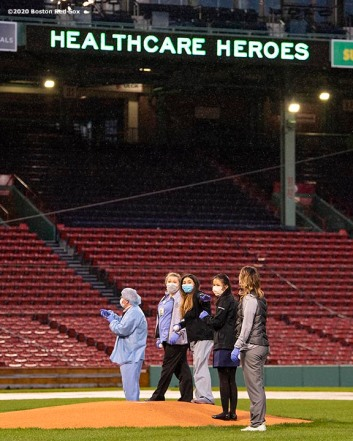 BOSTON, MA - APRIL 9: Medical professionals from Beth Israel Deaconess Medical Center are welcomed onto the empty field at Fenway Park in recognition of their work during the coronavirus pandemic on April 9, 2020 at Fenway Park in Boston, Massachusetts. The welcoming was filmed for the 'Some Good News With John Krasinski' YouTube series. (Photo by Billie Weiss/Boston Red Sox/Getty Images) *** Local Caption ***