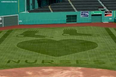 BOSTON, MA - MAY 6: A pattern with a message showing appreciation for nurses is displayed in the outfield grass as the Major League Baseball season is postponed due the coronavirus pandemic on May 6, 2020 at Fenway Park in Boston, Massachusetts. (Photo by Billie Weiss/Boston Red Sox/Getty Images) *** Local Caption ***