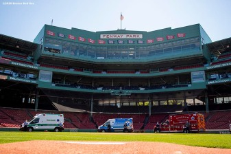 "BOSTON, MA - MAY 20: Ambulances drive around the warning track during the ""Convoy of Champions"" honoring Massachusetts EMS professionals with a convoy of 50 ambulances that traveled from UMass Medical Center in Worcester to Fenway Park during the coronavirus pandemic on May 20, 2020 at Fenway Park in Boston, Massachusetts. (Photo by Billie Weiss/Boston Red Sox/Getty Images) *** Local Caption ***"