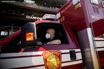 "BOSTON, MA - MAY 20: An EMT looks on during the ""Convoy of Champions"" honoring Massachusetts EMS professionals with a convoy of 50 ambulances that traveled from UMass Medical Center in Worcester to Fenway Park during the coronavirus pandemic on May 20, 2020 at Fenway Park in Boston, Massachusetts. (Photo by Billie Weiss/Boston Red Sox/Getty Images) *** Local Caption ***"