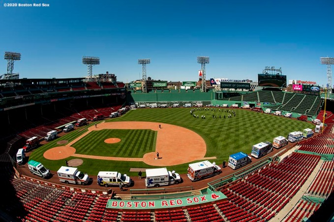"BOSTON, MA - MAY 20: A general view as ambulances are positioned around the warning track during the ""Convoy of Champions"" honoring Massachusetts EMS professionals with a convoy of 50 ambulances that traveled from UMass Medical Center in Worcester to Fenway Park during the coronavirus pandemic on May 20, 2020 at Fenway Park in Boston, Massachusetts. (Photo by Billie Weiss/Boston Red Sox/Getty Images) *** Local Caption ***"