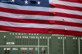 BOSTON, MA - MAY 25: The American flag is dropped over the Green Monster on Memorial Day as the Major League Baseball season is postponed due to the coronavirus pandemic on May 25, 2020 at Fenway Park in Boston, Massachusetts. (Photo by Billie Weiss/Boston Red Sox/Getty Images) *** Local Caption ***