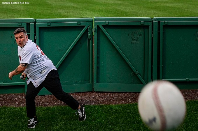 May 28, 2020, Boston, MA: Lead singer Ken Casey throws a baseball as he prepares to enter the field from the bullpen as the Dropkick Murphys perform during the Streaming Outta Fenway Presented By Pega free livestream performance with no live audience as the Major League Baseball season is postponed due to the coronavirus pandemic at Fenway Park in Boston, Massachusetts Thursday, May 28, 2020. (Photo by Billie Weiss/Pega)