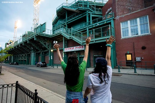 May 29, 2020, Boston, MA: Fans watch from outside the ballpark as the Dropkick Murphys perform during the Streaming Outta Fenway Presented By Pega free livestream performance with no live audience as the Major League Baseball season is postponed due to the coronavirus pandemic at Fenway Park in Boston, Massachusetts Friday, May 29, 2020. (Photo by Billie Weiss/Pega)