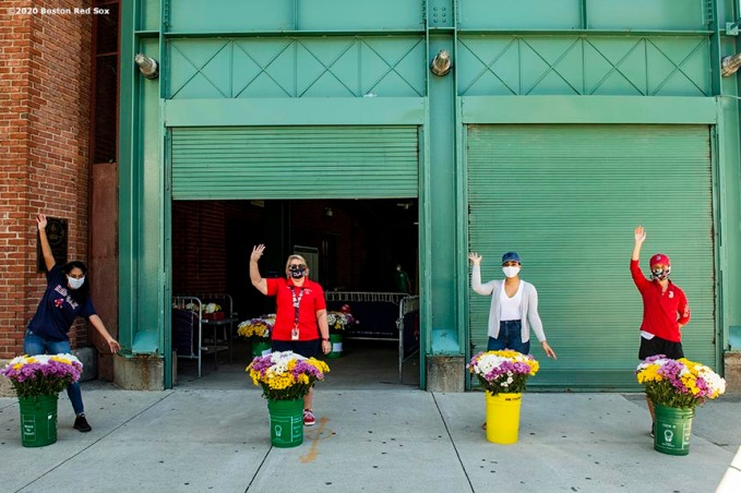 BOSTON, MA - JUNE 4: Boston Red Sox employees pose with flower arrangements before delivering them to senior centers in the Boston area as the Major League Baseball season is postponed due the coronavirus pandemic on June 4, 2020 at Fenway Park in Boston, Massachusetts. (Photo by Billie Weiss/Boston Red Sox/Getty Images) *** Local Caption ***