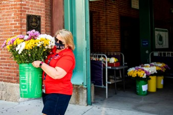 BOSTON, MA - JUNE 4: Pamela Sanford of the Boston Red Sox delivers flower arrangements to senior centers in the Boston area as the Major League Baseball season is postponed due the coronavirus pandemic on June 4, 2020 at Fenway Park in Boston, Massachusetts. (Photo by Billie Weiss/Boston Red Sox/Getty Images) *** Local Caption ***