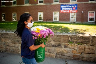 DORCHESTER, MA - JUNE 4: Lidia Zayas of the Boston Red Sox Foundation delivers a flower arrangement to the St. Joseph Rehab & Nursing Center as the Major League Baseball season is postponed due the coronavirus pandemic on June 4, 2020 in Dorchester, Massachusetts. (Photo by Billie Weiss/Boston Red Sox/Getty Images) *** Local Caption ***