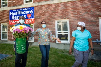DORCHESTER, MA - JUNE 4: Lidia Zayas of the Boston Red Sox Foundation poses as she delivers a flower arrangement to the St. Joseph Rehab & Nursing Center as the Major League Baseball season is postponed due the coronavirus pandemic on June 4, 2020 in Dorchester, Massachusetts. (Photo by Billie Weiss/Boston Red Sox/Getty Images) *** Local Caption ***