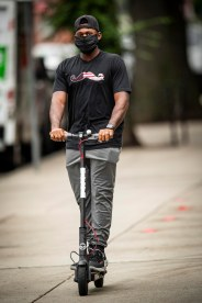 BOSTON, MA - JULY 1: Jackie Bradley Jr. #19 of the Boston Red Sox arrives on a scooter in advance of a training period before the start of the 2020 Major League Baseball season on July 1, 2020 at Fenway Park in Boston, Massachusetts. The season was delayed due to the coronavirus pandemic. (Photo by Billie Weiss/Boston Red Sox/Getty Images) *** Local Caption *** Jackie Bradley Jr.