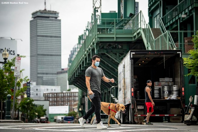 BOSTON, MA - JULY 1: Michael Chavis #23 of the Boston Red Sox walks his dog as he arrives in advance of a training period before the start of the 2020 Major League Baseball season on July 1, 2020 at Fenway Park in Boston, Massachusetts. The season was delayed due to the coronavirus pandemic. (Photo by Billie Weiss/Boston Red Sox/Getty Images) *** Local Caption *** Michael Chavis