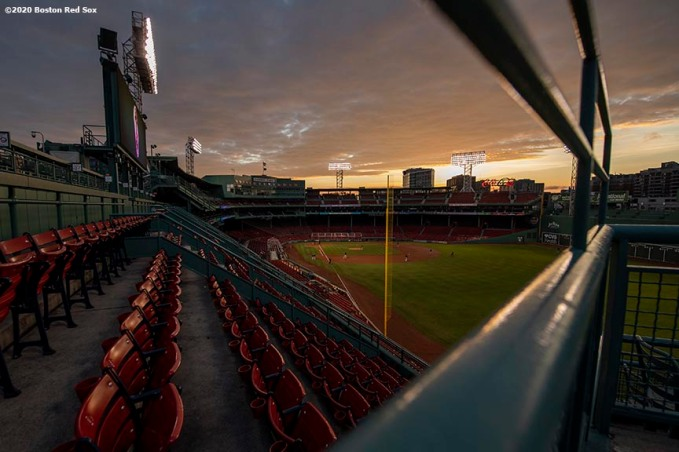 BOSTON, MA - JULY 17: A general view as the sun sets during a Boston Red Sox intra squad game during a summer camp workout before the start of the 2020 Major League Baseball season on July 17, 2020 at Fenway Park in Boston, Massachusetts. The season was delayed due to the coronavirus pandemic. (Photo by Billie Weiss/Boston Red Sox/Getty Images) *** Local Caption ***