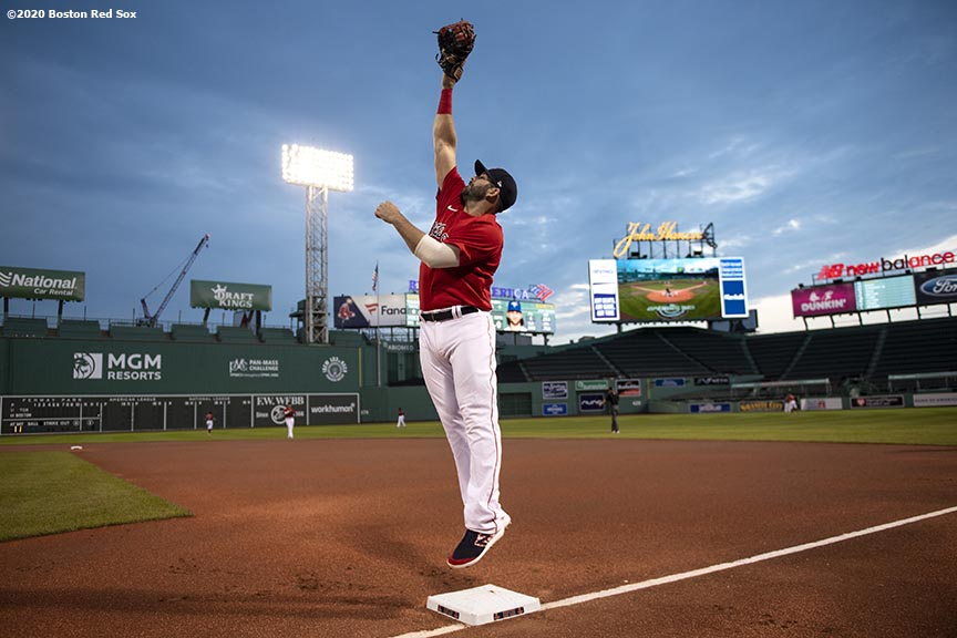 BOSTON, MA - JULY 22: Mitch Moreland #18 of the Boston Red Sox leaps to catch a ball before an exhibition game against the Toronto Blue Jays before the start of the 2020 Major League Baseball season on July 22, 2020 at Fenway Park in Boston, Massachusetts. The season was delayed due to the coronavirus pandemic. (Photo by Billie Weiss/Boston Red Sox/Getty Images) *** Local Caption *** Mitch Moreland