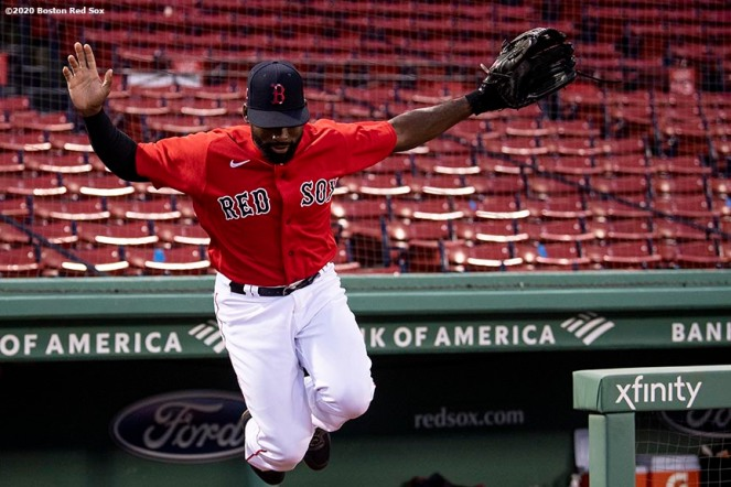 BOSTON, MA - JULY 22: Jackie Bradley Jr. #19 of the Boston Red Sox leaps out of the dugout before an exhibition game against the Toronto Blue Jays before the start of the 2020 Major League Baseball season on July 22, 2020 at Fenway Park in Boston, Massachusetts. The season was delayed due to the coronavirus pandemic. (Photo by Billie Weiss/Boston Red Sox/Getty Images) *** Local Caption *** Jackie Bradley Jr.