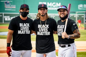 BOSTON, MA - JULY 24: Jose Peraza #3, Jonathan Arauz #36, and Michael Chavis #23 of the Boston Red Sox pose for a photograph as they wear Black Lives Matter shirts before the Opening Day game against the Baltimore Orioles on July 24, 2020 at Fenway Park in Boston, Massachusetts. The 2020 season had been postponed since March due to the COVID-19 pandemic. (Photo by Billie Weiss/Boston Red Sox/Getty Images) *** Local Caption *** Jose Peraza; Jonathan Arauz; Michael Chavis