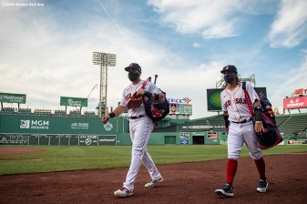 BOSTON, MA - JULY 24: Jose Peraza #3 and Jonathan Arauz #36 of the Boston Red Sox walk onto the field before the Opening Day game against the Baltimore Orioles on July 24, 2020 at Fenway Park in Boston, Massachusetts. The 2020 season had been postponed since March due to the COVID-19 pandemic. (Photo by Billie Weiss/Boston Red Sox/Getty Images) *** Local Caption *** Jonathan Arauz; Jose Peraza