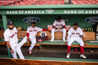 BOSTON, MA - JULY 24: Jose Peraza #3, Rafael Devers #11, Michael Chavis #23, and Xander Bogaerts #2 of the Boston Red Sox sit in the dugout before the Opening Day game against the Baltimore Orioles on July 24, 2020 at Fenway Park in Boston, Massachusetts. The 2020 season had been postponed since March due to the COVID-19 pandemic. (Photo by Billie Weiss/Boston Red Sox/Getty Images) *** Local Caption *** Jose Peraza; Rafael Devers; Michael Chavis; Xander Bogaerts