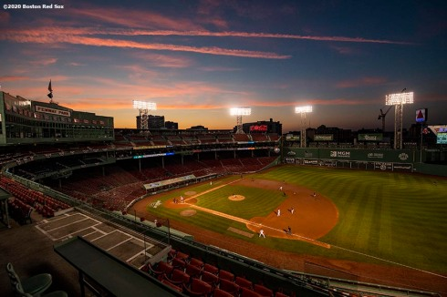 BOSTON, MA - JULY 24: A general view as the sun sets during the Opening Day game between the Boston Red Sox and the Baltimore Orioles on July 24, 2020 at Fenway Park in Boston, Massachusetts. The 2020 season had been postponed since March due to the COVID-19 pandemic. (Photo by Billie Weiss/Boston Red Sox/Getty Images) *** Local Caption ***