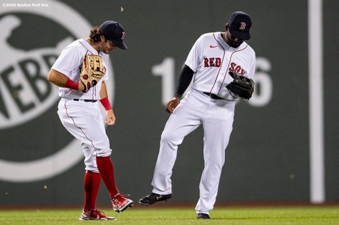 BOSTON, MA - JULY 24: Andrew Benintendi #16 reacts with Jackie Bradley Jr. #19 of the Boston Red Sox after a victory during the Opening Day game against the Baltimore Orioles on July 24, 2020 at Fenway Park in Boston, Massachusetts. The 2020 season had been postponed since March due to the COVID-19 pandemic. (Photo by Billie Weiss/Boston Red Sox/Getty Images) *** Local Caption *** Andrew Benintendi; Jackie Bradley Jr.