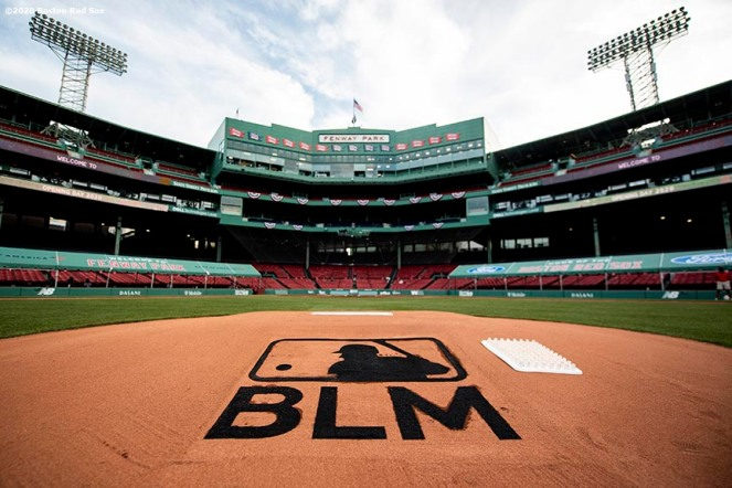 BOSTON, MA - JULY 24: The Black Lives Matter Major League Baseball logo is painted as a stencil on the pitchers mound during a pre-game ceremony before the Opening Day game between the Boston Red Sox and the Baltimore Orioles on July 24, 2020 at Fenway Park in Boston, Massachusetts. The 2020 season had been postponed since March due to the COVID-19 pandemic. (Photo by Billie Weiss/Boston Red Sox/Getty Images) *** Local Caption ***