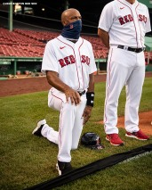 BOSTON, MA - JULY 24: First base coach Tom Goodwin of the Boston Red Sox kneels during the National Anthem during a pre-game ceremony before the Opening Day game against the Baltimore Orioles on July 24, 2020 at Fenway Park in Boston, Massachusetts. The 2020 season had been postponed since March due to the COVID-19 pandemic. (Photo by Billie Weiss/Boston Red Sox/Getty Images) *** Local Caption *** Tom Goodwin