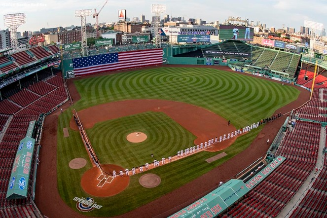 BOSTON, MA - JULY 24: A general view as starting lineups are introduced during the National Anthem ceremony before the Opening Day game between the Boston Red Sox and the Baltimore Orioles on July 24, 2020 at Fenway Park in Boston, Massachusetts. The 2020 season had been postponed since March due to the COVID-19 pandemic. (Photo by Billie Weiss/Boston Red Sox/Getty Images) *** Local Caption ***