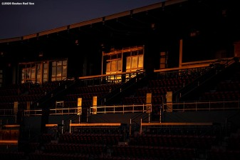 BOSTON, MA - JULY 24: Light reflects off of the suite level as the sun rises before the Opening Day game between the Boston Red Sox and the Baltimore Orioles on July 24, 2020 at Fenway Park in Boston, Massachusetts. The Major League Baseball season was delayed due to the coronavirus pandemic. (Photo by Billie Weiss/Boston Red Sox/Getty Images) *** Local Caption ***