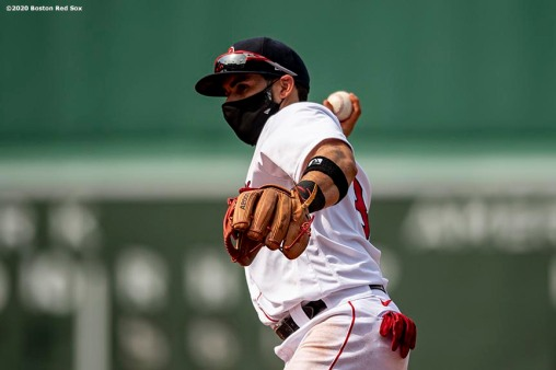 BOSTON, MA - JULY 25: Jose Peraza #3 of the Boston Red Sox wears a mask as he throws during the seventh inning of a game against the Baltimore Orioles on July 25, 2020 at Fenway Park in Boston, Massachusetts. The Major League Baseball season was delayed due to the coronavirus pandemic. (Photo by Billie Weiss/Boston Red Sox/Getty Images) *** Local Caption *** Jose Peraza