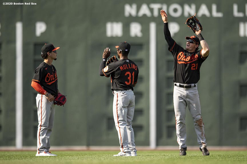 BOSTON, MA - JULY 25: Austin Hays #21, Cedric Mullins #31, and Andrew Velazquez #313 of the Baltimore Orioles celebrate a victory against the Boston Red Sox on July 25, 2020 at Fenway Park in Boston, Massachusetts. The Major League Baseball season was delayed due to the coronavirus pandemic. (Photo by Billie Weiss/Boston Red Sox/Getty Images) *** Local Caption *** Austin Hays; Cedric Mullins; Andrew Velazquez