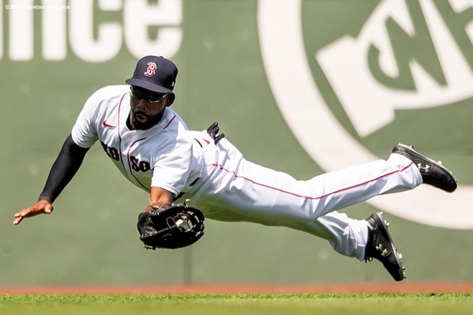 BOSTON, MA - JULY 26: Jackie Bradley Jr. #19 of the Boston Red Sox makes a diving catch during the second inning of a game against the Baltimore Orioles on July 26, 2020 at Fenway Park in Boston, Massachusetts. The 2020 season had been postponed since March due to the COVID-19 pandemic. (Photo by Billie Weiss/Boston Red Sox/Getty Images) *** Local Caption *** Jackie Bradley Jr.