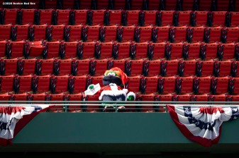 BOSTON, MA - JULY 26: Mascot Wally the Green Monster of the Boston Red Sox wears a Santa suit as he looks on during the fourth inning of a game against the Baltimore Orioles on July 26, 2020 at Fenway Park in Boston, Massachusetts. The 2020 season had been postponed since March due to the COVID-19 pandemic. (Photo by Billie Weiss/Boston Red Sox/Getty Images) *** Local Caption ***