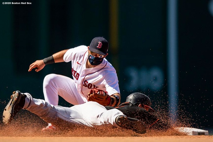 BOSTON, MA - JULY 26: Jose Peraza #21 of the Boston Red Sox tags out Austin Hays #21 of the Baltimore Orioles as he attempts to steal second base during the sixth inning of a game on July 26, 2020 at Fenway Park in Boston, Massachusetts. The 2020 season had been postponed since March due to the COVID-19 pandemic. (Photo by Billie Weiss/Boston Red Sox/Getty Images) *** Local Caption *** Jose Peraza