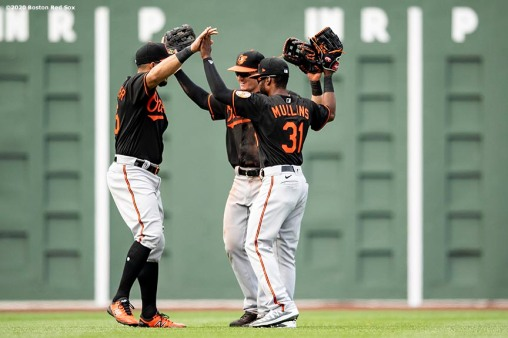 BOSTON, MA - JULY 26: Anthony Santander #25, Austin Hays #21, and Cedric Mullins #31 of the Baltimore Orioles celebrate a victory against the Boston Red Sox on July 26, 2020 at Fenway Park in Boston, Massachusetts. The 2020 season had been postponed since March due to the COVID-19 pandemic. (Photo by Billie Weiss/Boston Red Sox/Getty Images) *** Local Caption *** Anthony Santander; Austin Hays; Cedric Mullins