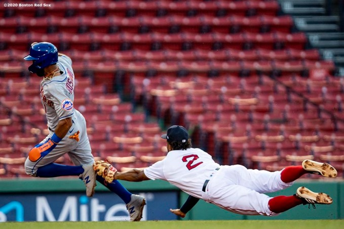 BOSTON, MA - JULY 27: Amed Rosario #1 of the New York Mets avoids the tag of Xander Bogaerts #2 of the Boston Red Sox as he advances to third base during the first inning of a game on July 27, 2020 at Fenway Park in Boston, Massachusetts. The 2020 season had been postponed since March due to the COVID-19 pandemic. (Photo by Billie Weiss/Boston Red Sox/Getty Images) *** Local Caption *** Amed Rosario; Xander Bogaerts