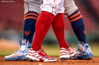 BOSTON, MA - JULY 27: The cleats of Andrew Benintendi #16 of the Boston Red Sox and Pete Alonso #20 of the New York Mets are shown during the first inning of a game on July 27, 2020 at Fenway Park in Boston, Massachusetts. The 2020 season had been postponed since March due to the COVID-19 pandemic. (Photo by Billie Weiss/Boston Red Sox/Getty Images) *** Local Caption *** Andrew Benintendi; Pete Alonso