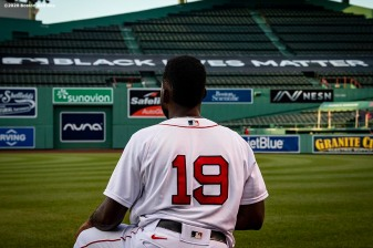 BOSTON, MA - JULY 28: Jackie Bradley Jr. #19 of the Boston Red Sox kneels in front of a Black Lives Matter tarp sign during the National Anthem before a game against the New York Mets on July 28, 2020 at Fenway Park in Boston, Massachusetts. The 2020 season had been postponed since March due to the COVID-19 pandemic. (Photo by Billie Weiss/Boston Red Sox/Getty Images) *** Local Caption *** Jackie Bradley Jr.