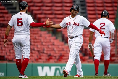 BOSTON, MA - AUGUST 19: Rafael Devers #11 of the Boston Red Sox high fives Kevin Pillar #5 after hitting a two run home run during the third inning of a game against the Philadelphia Phillies on August 19, 2020 at Fenway Park in Boston, Massachusetts. The 2020 season had been postponed since March due to the COVID-19 pandemic. (Photo by Billie Weiss/Boston Red Sox/Getty Images) *** Local Caption *** Rafael Devers; Kevin Pillar