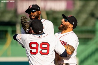 BOSTON, MA - AUGUST 19: Jackie Bradley Jr. #19, Kevin Pillar #5, and Alex Verdugo #99 of the Boston Red Sox celebrate a victory against the Philadelphia Phillies on August 19, 2020 at Fenway Park in Boston, Massachusetts. The 2020 season had been postponed since March due to the COVID-19 pandemic. (Photo by Billie Weiss/Boston Red Sox/Getty Images) *** Local Caption *** Jackie Bradley Jr.; Alex Verdugo; Kevin Pillar