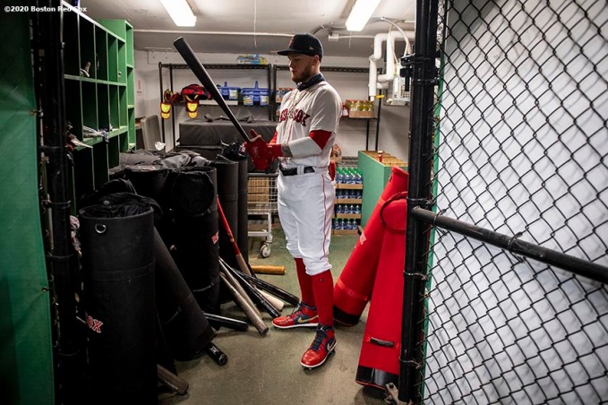 BOSTON, MA - AUGUST 31: Alex Verdugo #99 of the Boston Red Sox looks at his bat before a game against the Atlanta Braves on August 31, 2020 at Fenway Park in Boston, Massachusetts. The 2020 season had been postponed since March due to the COVID-19 pandemic. (Photo by Billie Weiss/Boston Red Sox/Getty Images) *** Local Caption *** Alex Verdugo