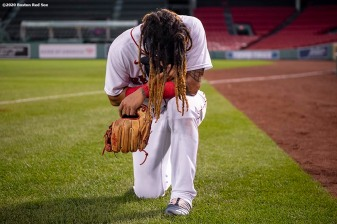 BOSTON, MA - AUGUST 31: Jonathan Arauz #36 of the Boston Red Sox prays before a game against the Atlanta Braves on August 31, 2020 at Fenway Park in Boston, Massachusetts. The 2020 season had been postponed since March due to the COVID-19 pandemic. (Photo by Billie Weiss/Boston Red Sox/Getty Images) *** Local Caption *** Jonathan Arauz